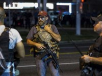 Photo Credit -  REUTERS/Lucas Jackson Members of the Oath Keepers walk with their personal weapons on the street during protests in Ferguson, Missouri August 11, 2015.
