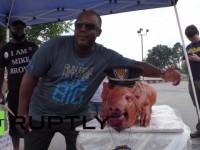 Ferguson Protesters Eat 'Darren Wilson' Pig's Head Outside Police Station… (Video)