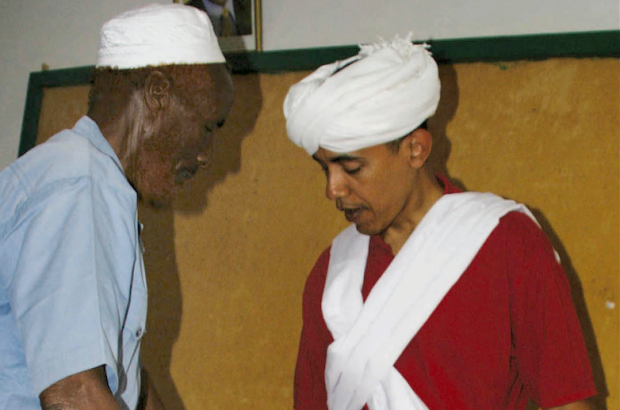 In this 2006 file photo, then-Sen. Barack Obama, D-Ill., right, is dressed as a Somali Elder by Sheikh Mahmed Hassan, left, during his visit to Wajir, a rural area in northeastern Kenya, near the borders with Somalia and Ethiopia. (AP Photo, File)