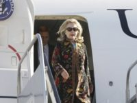 U.S. Secretary of State Hillary Rodham Clinton steps off her plane as she arrives in Los Cabos, Mexico, for the G20 foreign ministers summit, Saturday, Feb. 18, 2012. (AP Photo/Charles Dharapak, Pool)