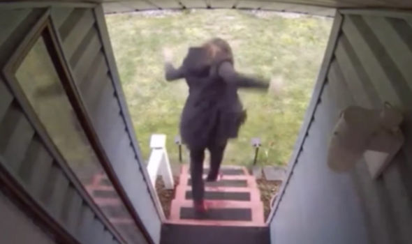 The woman screams and runs when she is caught trying to take the package