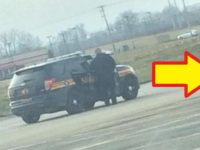 LOOK! Photo Of Cop Goes VIRAL When People Spot Who's Lurking Behind Him…